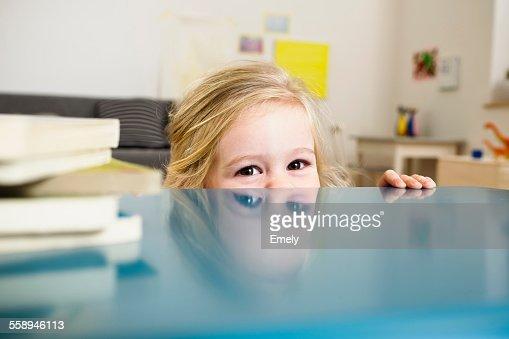 Girl peeking over table