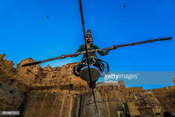 A girl perform street play outside the Jaisalmer fort of Rajasthan India on 11 Feb2017Jaisalmer About nicknamed quotThe Golden cityquot is a city in...