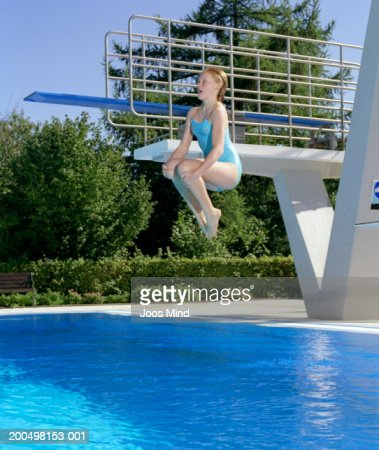 Girl Performing Cannonball Jump Into Swimming Pool Stock Photo Getty Images