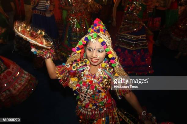 A girl performs dandiya dance at 'Thane Raas Rang Navratri Festival' at Modella Mill Compound Thane on September 23 2017 in Mumbai India Dandiya Raas...
