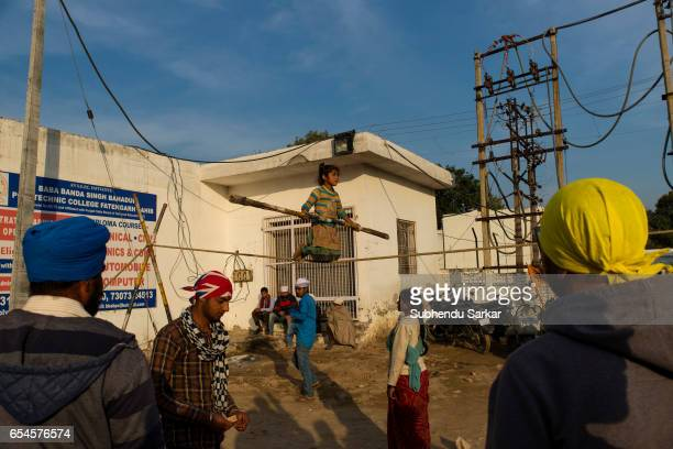 A girl performs rope trick to collect alms during Hola Mohalla festival Hola Mohalla is a threeday festival started by the tenth Sikh Guru Govind...