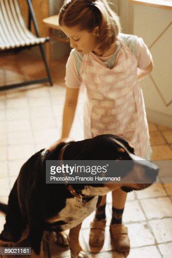 Girl petting dog : Stock Photo
