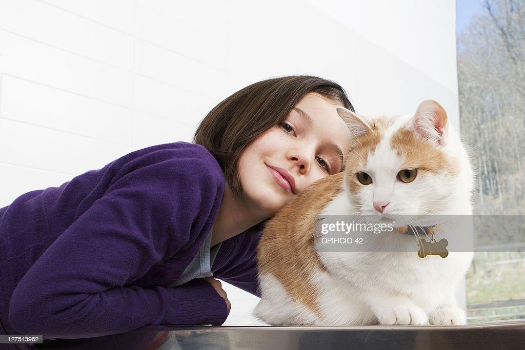 Girl petting her cat : Stock Photo