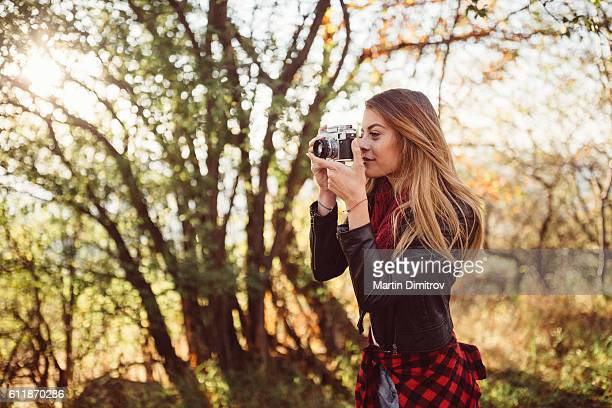 Girl photographing the autumn season