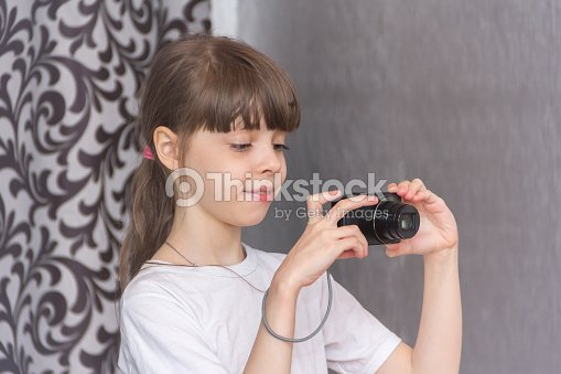 Girl photographs with a camera. : Stock Photo