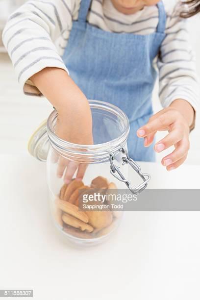 Girl Picking Cookies