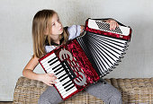 Girl concentration on playing an Accordion