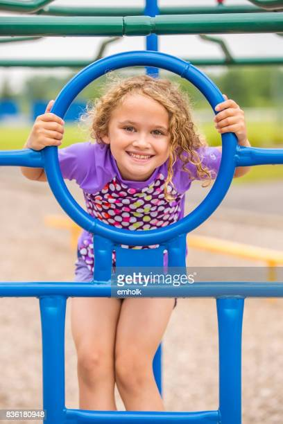 Girl Playing At Outdoor Playground Jungle Gym