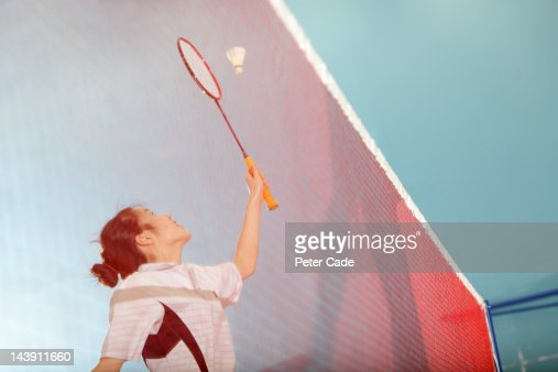girl playing badminton