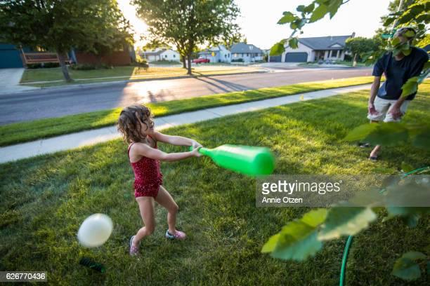 Girl Playing Base Ball