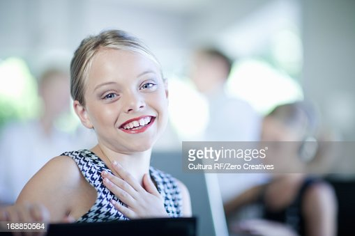 Girl playing businesswoman in chair : Stock Photo