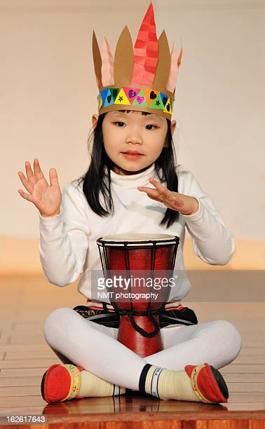 Girl playing djembe