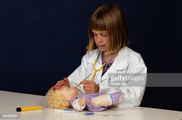 Girl Playing Doctor with Her Doll
