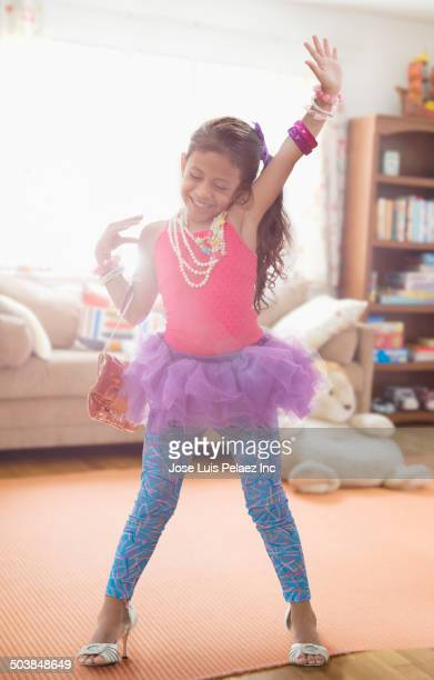 Girl playing dress up in living room