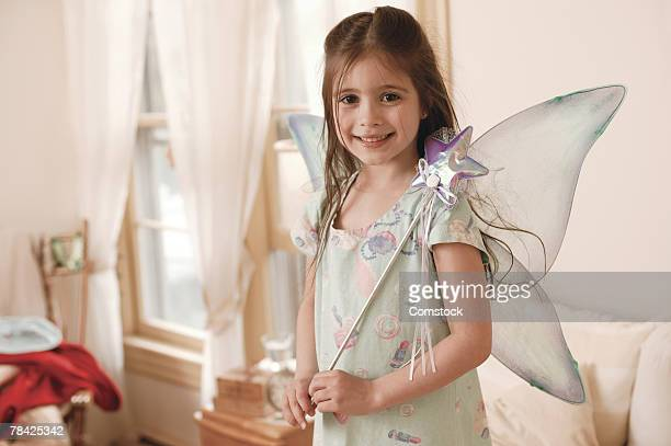 Girl playing dress-up in fairy costume