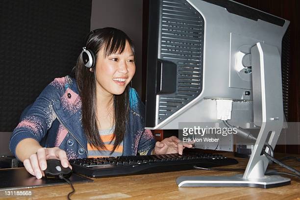 girl playing games on desktop computer