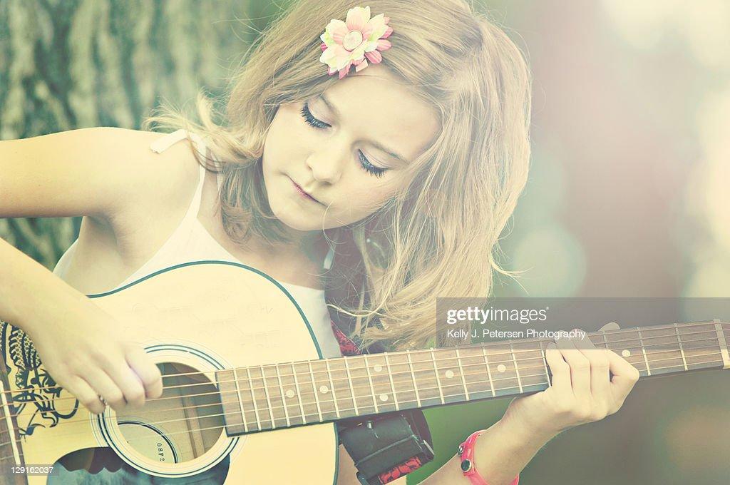 Girl playing guitar : Stock Photo