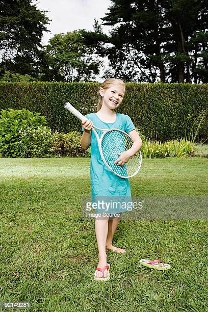 Girl playing guitar with a tennis racket