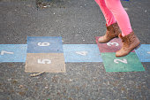 Girl playing Hop scotch