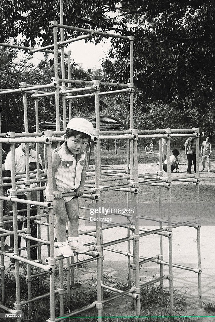 Girl playing in a playground : Stock Photo