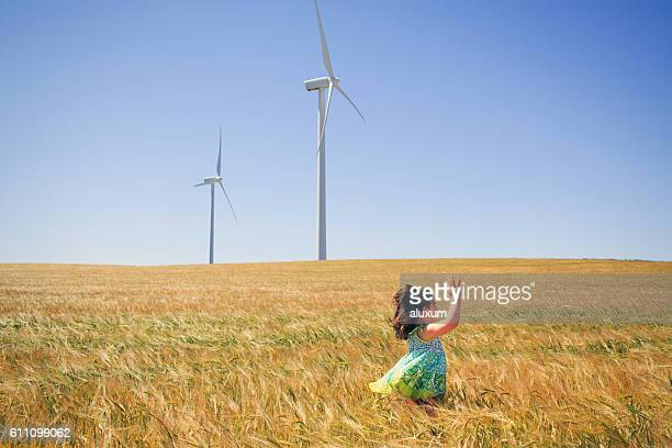 Girl playing in cereal field