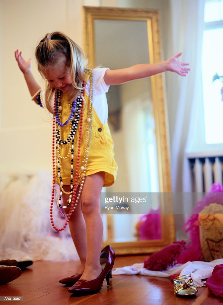 Girl Playing in Dress-Up Clothes