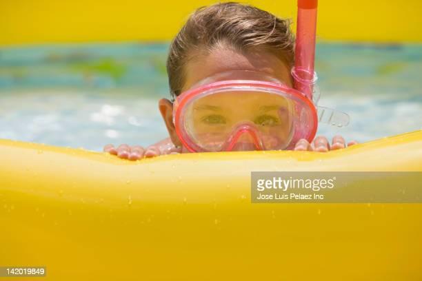 Girl playing in kiddie pool