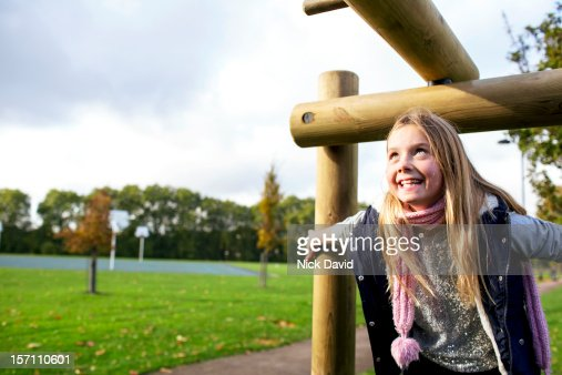 Girl playing in park : Stock Photo