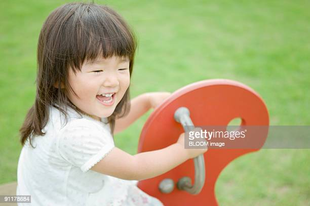 Girl playing in park, smiling