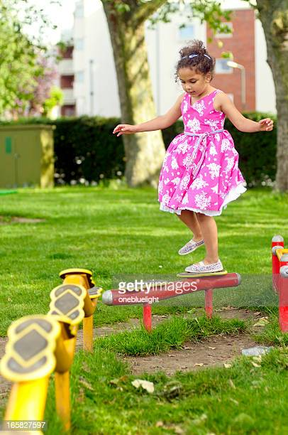 Girl (6-7) Playing In Playground
