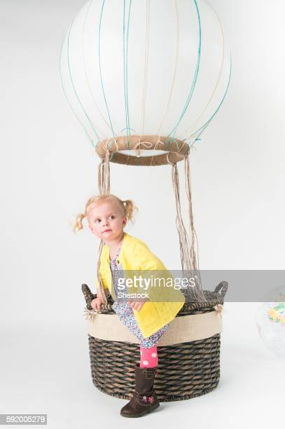 Girl playing in pretend hot air balloon