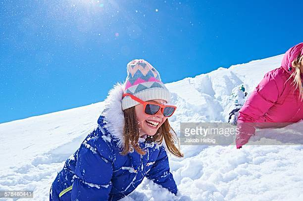 Girl playing in snow, Chamonix, France