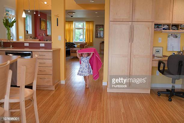 Girl playing in the kitchen of a disability accessible home