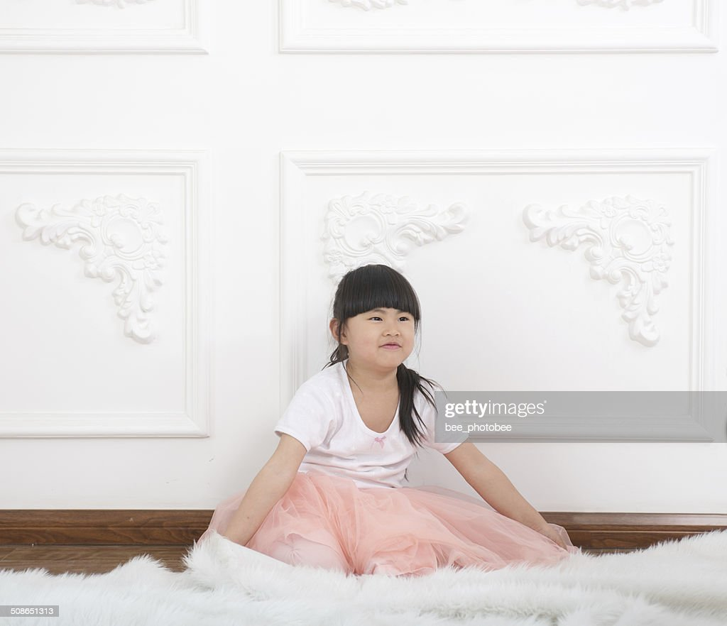 Girl playing in the room : Stock Photo