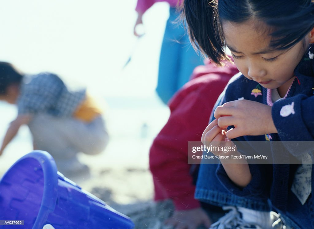 Girl Playing in the Sand, Venice, California : Stock Photo