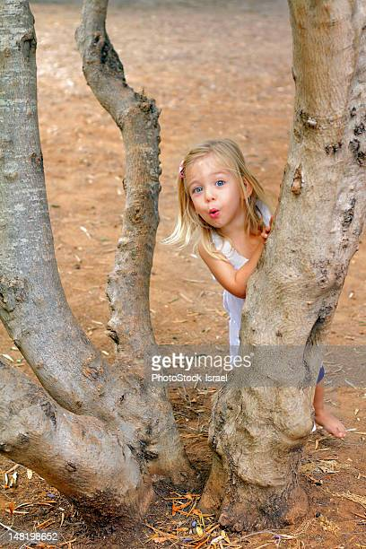 Girl playing in tree in park