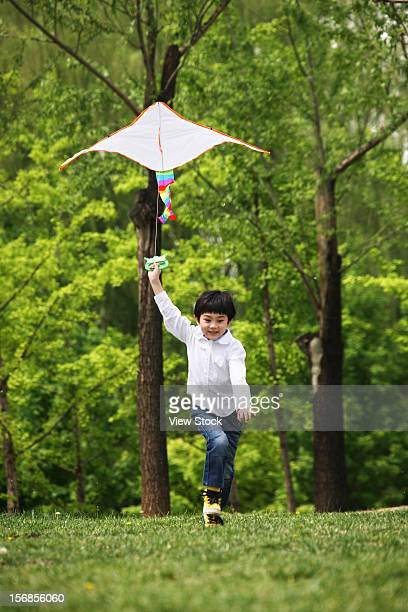 A girl playing kite outside