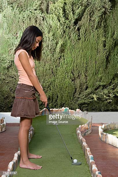 Girl playing miniature golf