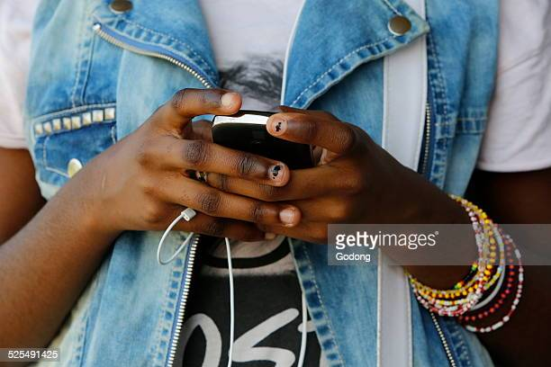 Girl playing music on a mobile phone
