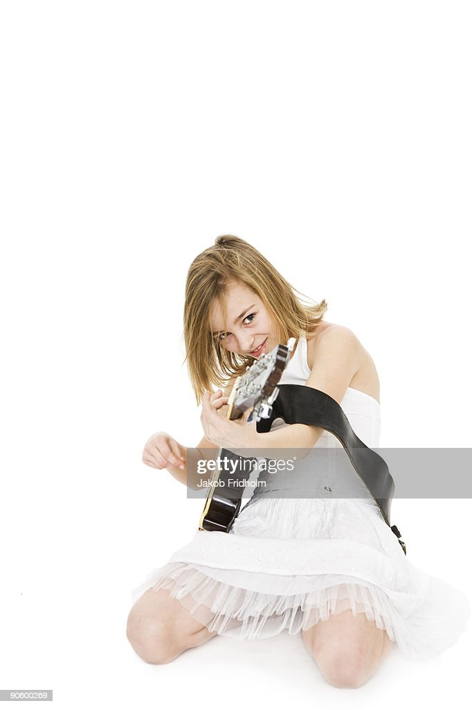 A girl playing music. : Stock Photo