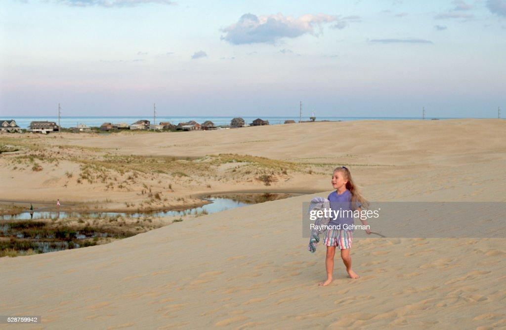 Girl Playing on Sand Dune