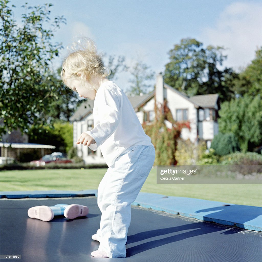 playing on trampoline in backyard stock photo getty images
