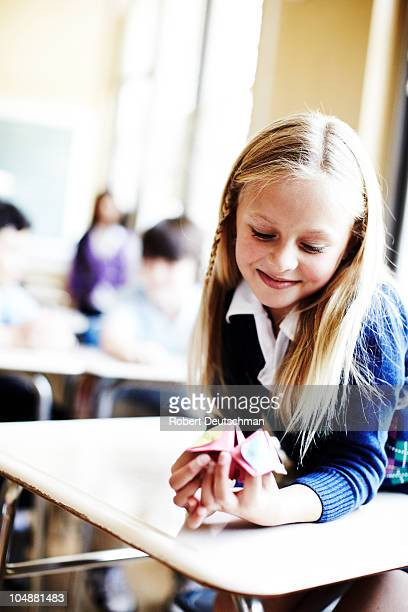 Girl playing origami fortune game