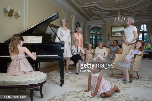 Girl (6-8) playing piano at party : Stock Photo