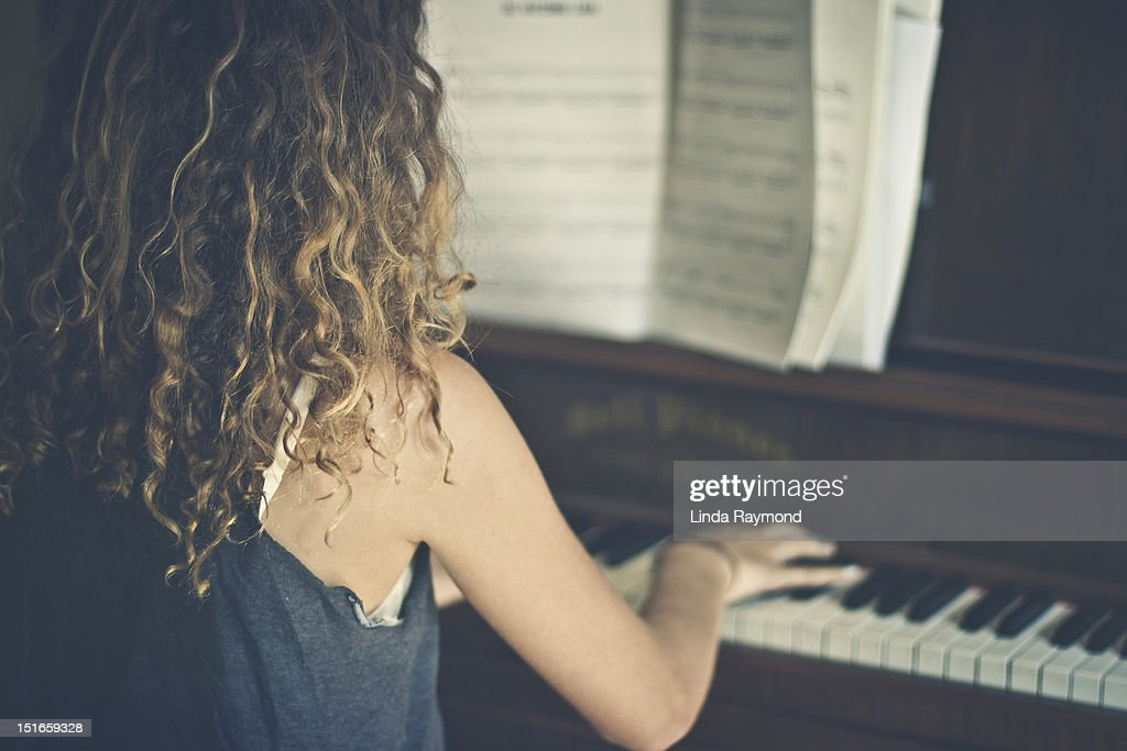 Girl Playing Piano Stock Photo | Getty Images
