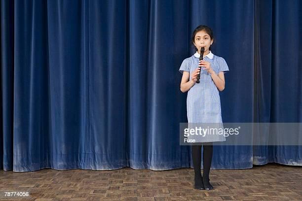 Girl Playing Recorder