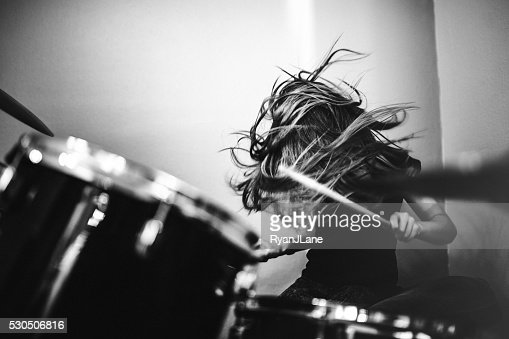 Girl Playing Rock and Roll Drums