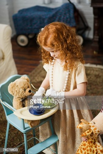 Girl playing tea party : Stock Photo