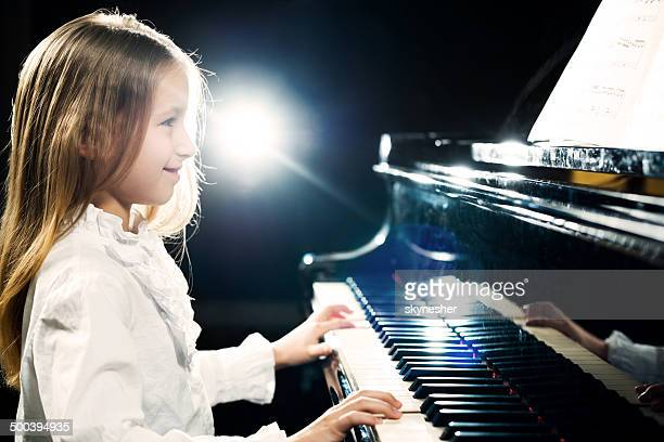Girl playing the piano.