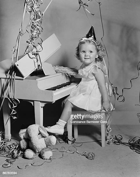 Girl playing toy piano